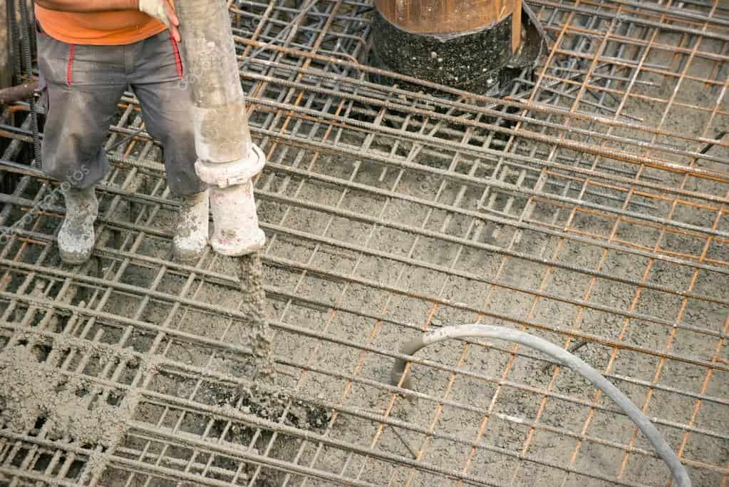 worker pouring concrete